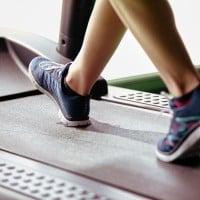 Person Walking On Cushioned Treadmill