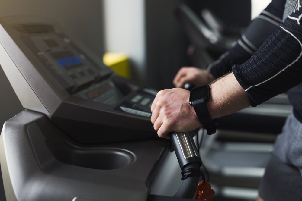 Why You Should Stop Holding Onto The Handrails On The Treadmill